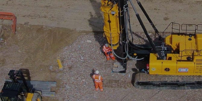 Drill with two men standing closeby